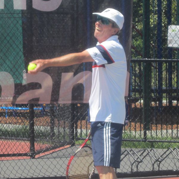 Owen Morgan serving it up at the Club Championships