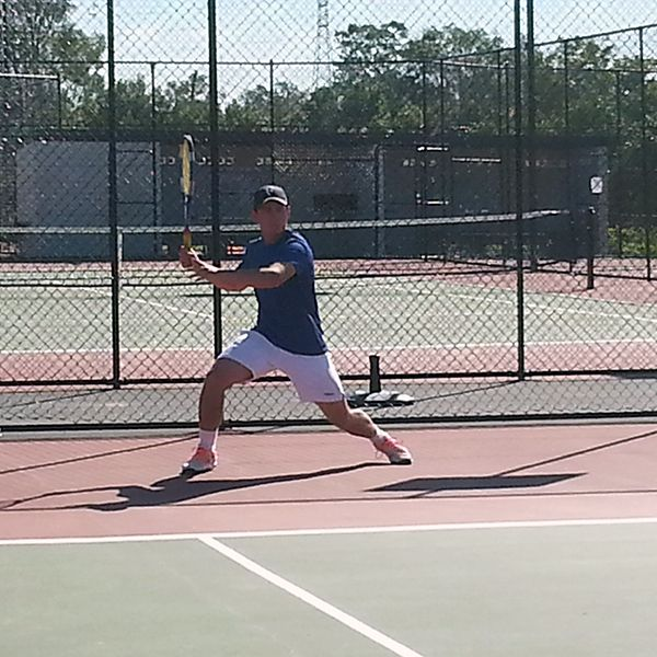 MTC Coach Ken Barter about to lay into a forehand